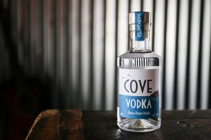 Cove Vodka 20cl and metal background