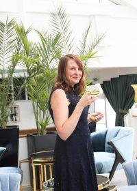 Leanne drinking a Cove Vodka Cocktail at Burgh Island