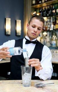 Viktor pouring Cove Vodka at Burgh Island